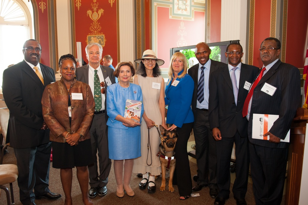 From left to right, John Boyd, AWI Board Member; Eve Ferguson, Reference Librarian, East Africa, African Section, The Library of Congress; Bill Clark, Honorary pilot-warden, Kenya Wildlife Service; Mary-Jane Deeb, PhD, Chief, African & Middle East Division, The Library of Congress; Sheila Hamanaka, Author and Illustrator of A Dangerous Life; Phil, Guide Dog; Cathy Liss, President, Animal Welfare Institute; Edwin Wanyonyi, Deputy Director for Strategy and Change, Kenya Wildlife Service; William Mugo, Consular Officer, Embassy of the Republic of Kenya; Ibrahim Ogle, Assistant Director Special Projects, Kenya Wildlife Service. Photo by Richard Greenhouse Photography