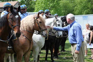 Cong. Patrick Meehan (R-PA) takes time to greet Papito of the Philadelphia Police Department's Mounted Unit after the press conference. - Photo by Alexandra Alberg