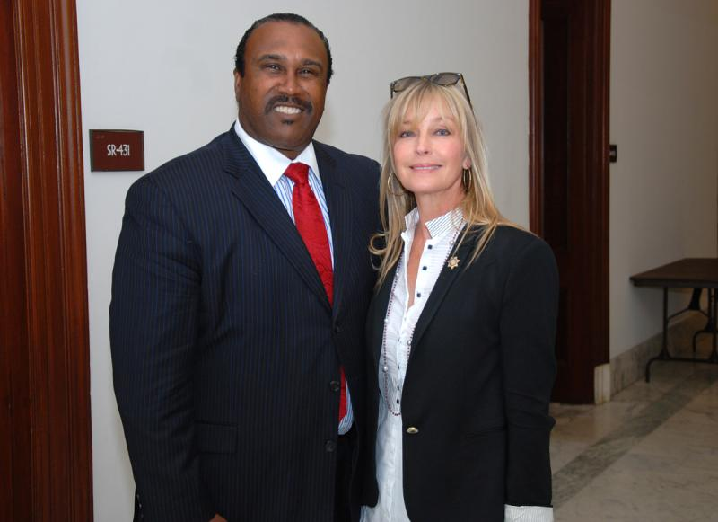 John Boyd, president of the national Black Farmers Association, and Bo Derek, AWI spokesperson, talking prior to the press conference.